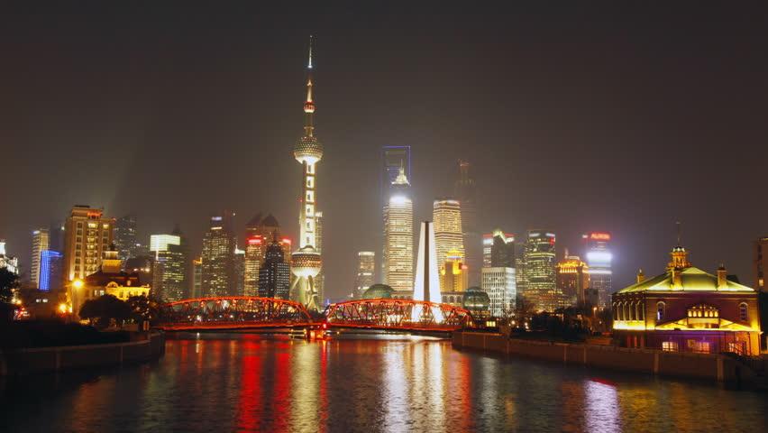 Time lapse of Shanghai Garden Bridge skyline at night - view from suzhou river,