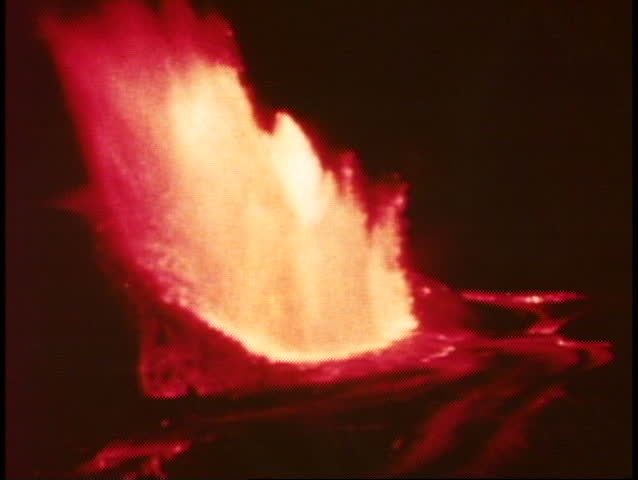 Volcanoes on the Big Island of Hawaii erupting at night, wide shot exploding - SD stock footage clip