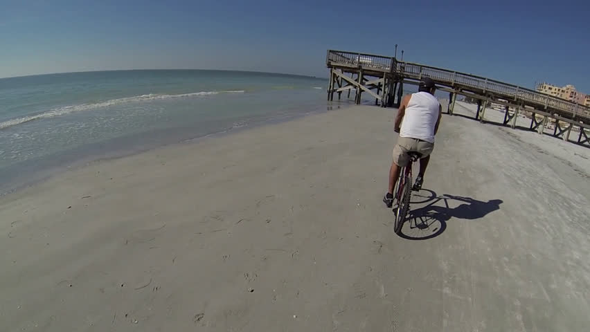 First person view of riding a bike on the beach. | Shutterstock HD Video #3897221