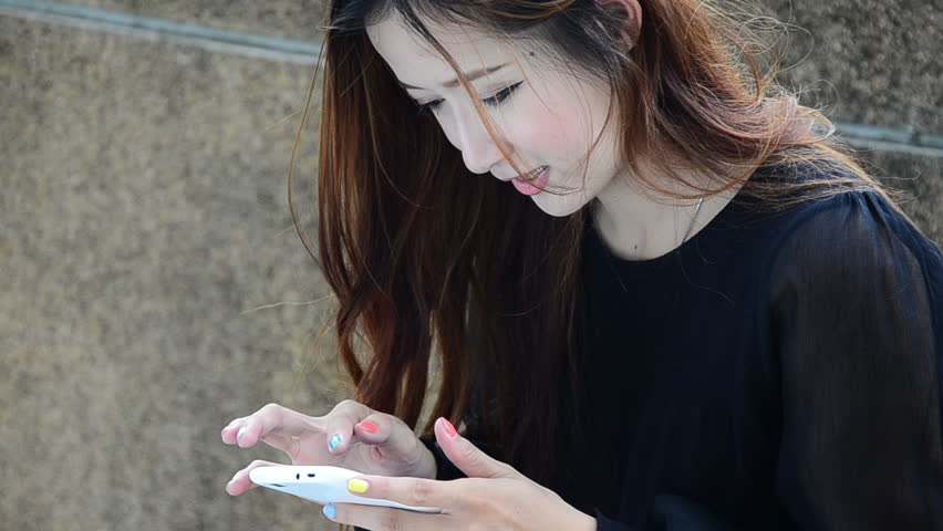 Close up beautiful young woman using a touch screen pad technology