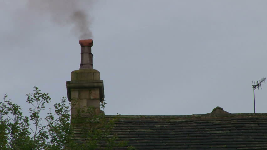 A modern house chimney with smoke billowing out. - HD stock footage clip