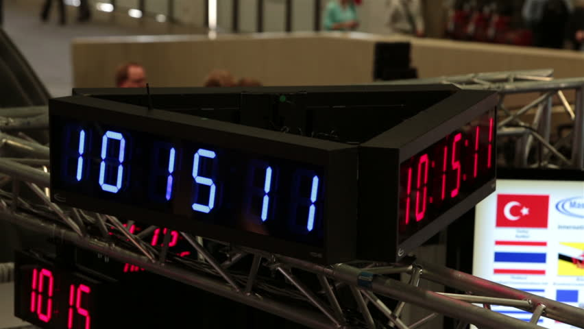 Electronic clock shows time spin at business convention fast motion. Business men and woman walk the floors and interact trade show in Las Vegas Convention Center. Annual meeting and trade show.  | Shutterstock HD Video #3903368