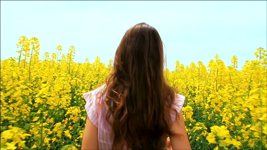 Young Woman in Vintage Dress Running through Yellow Field Touching Flowers HD #3913772