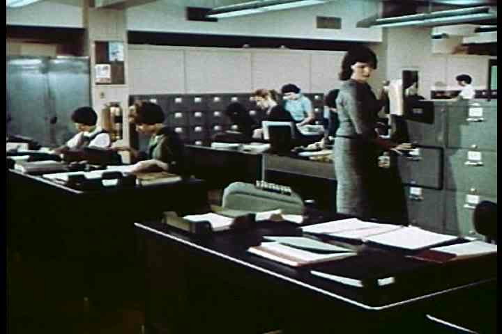 1950s - In 1950s offices, modern secretaries work for the phone company.