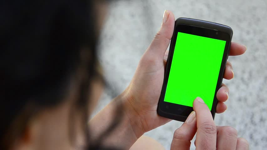 Business woman using a Smart phone Touchscreen CHROMA KEY- Close-up , Fingers make gestures touching and swiping the screen of a modern smartphone.