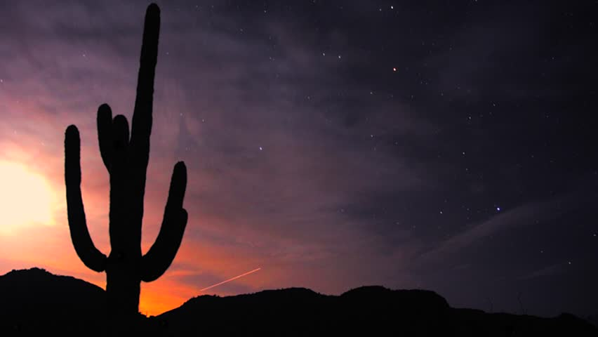 A time-lapse of the stars above the Harquahala Mountains in Arizona, USA. Sunset immediately followed by star lapse movement in space. Beautiful and artistic. Moon. - HD stock video clip