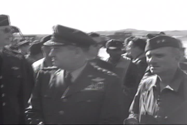 1950s - Medal ceremony and pilots being welcomed home from their flight by their wives - SD stock video clip