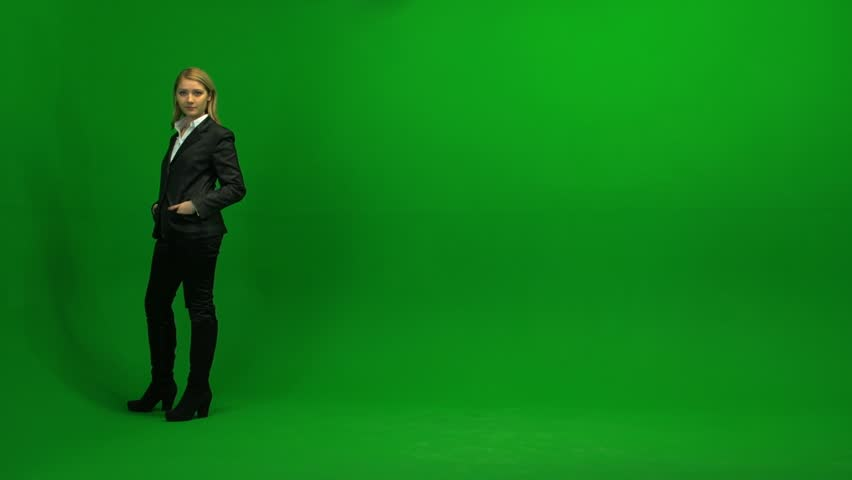 Blond women walking trough frame against green screen | Shutterstock HD Video #3954335