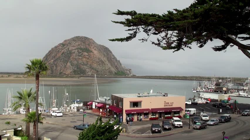 MORRO BAY - APRIL 02: View of the Morro Bay Harbor, with Morro Rock in the center. April 02, 2013 in Morro Bay, California, USA. - HD stock video clip