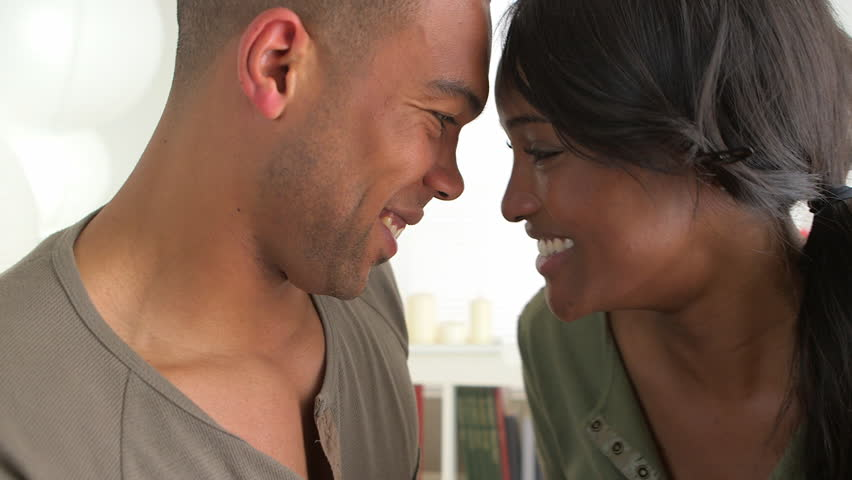 Cute African couple kissing - HD stock footage clip