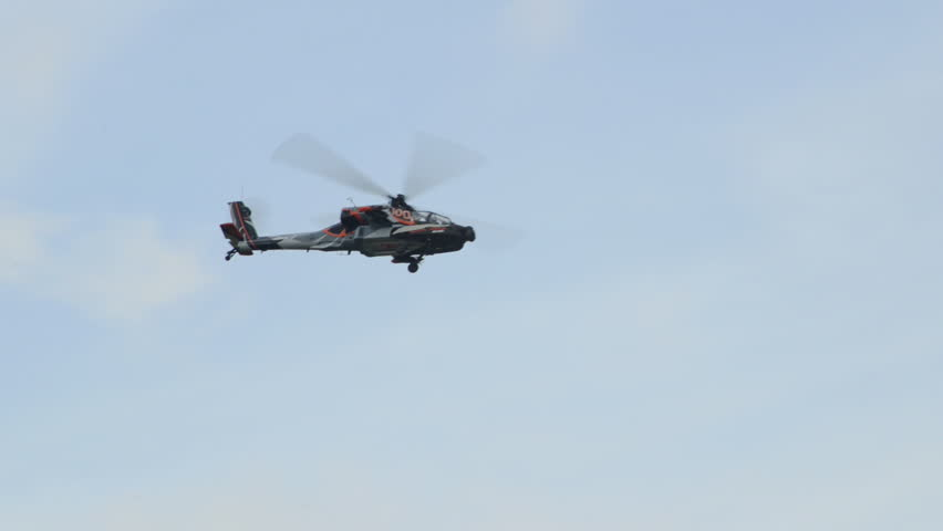 VOLKEL, NETHERLANDS - June 14 2013: An Apache AH-64 Helicopter performing a roll during an airshow at Volkel, Netherlands, June 14, 2013