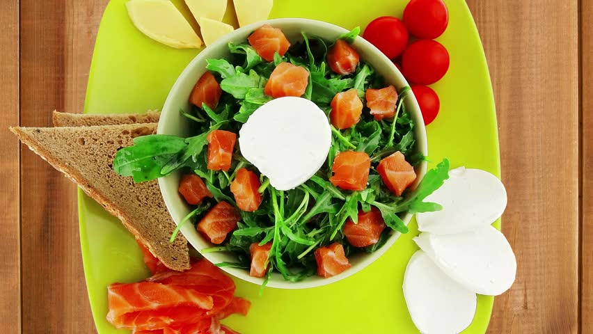fresh green salad with smoked salmon on plate 1920x1080 intro motion slow hidef hd