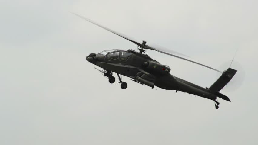 A Apache AH-64 Helicopter move his gun. 10968