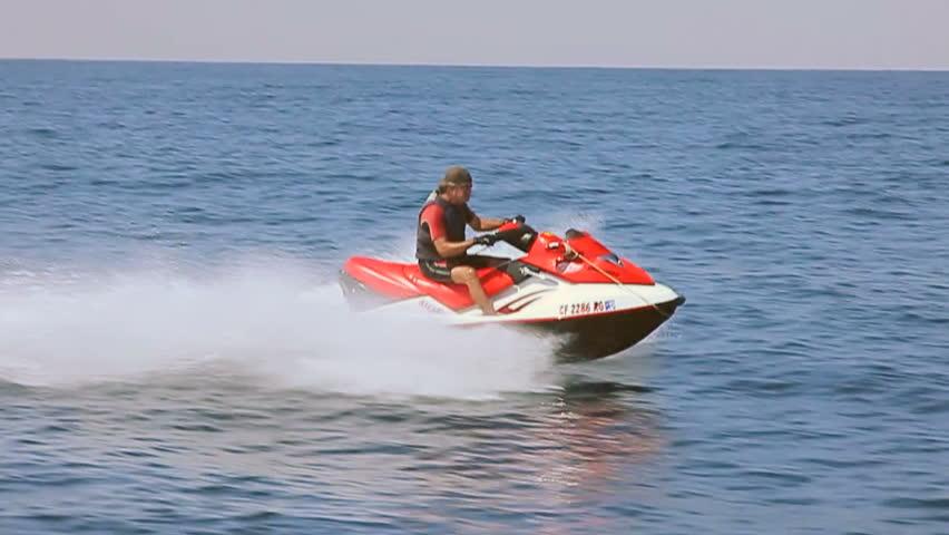 MAN ON A JET SKI. A man cruises the ocean on a jet ski. #4186175