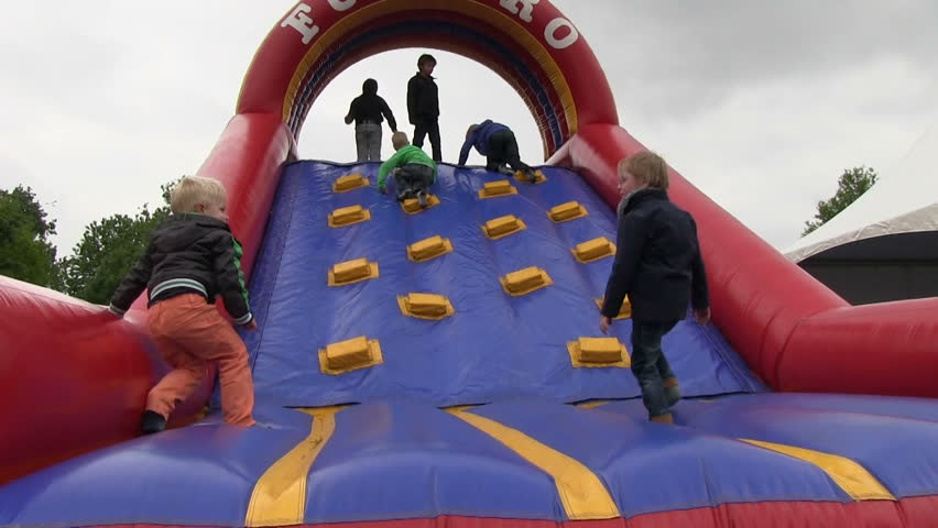 VOLKEL, THE NETHERLANDS - MAY 26, 2013:  Playful kids at airshow in Volkel 2013