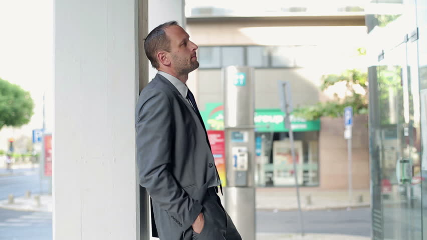Young businessman waiting for someone in the city