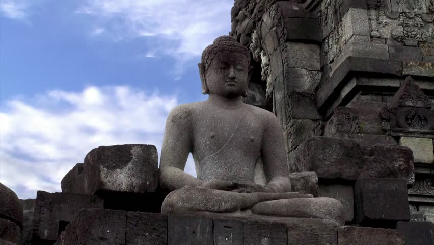 Statue of Buddha sitting in the lotus position. Borobudur Temple. Java, Indonesia.