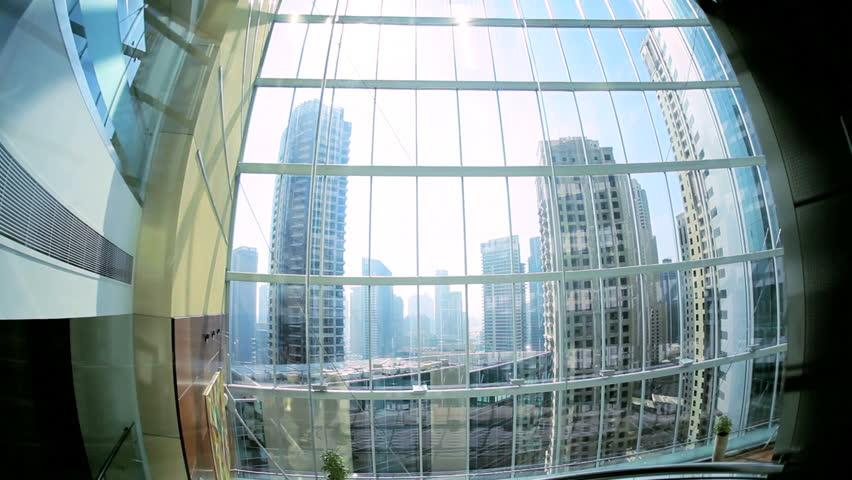Modern city elevator ascending skyscraper Dubai city centre, UAE, Middle East | Shutterstock HD Video #4234937