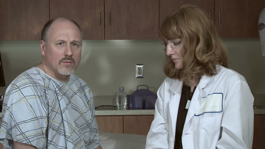 Female doctor gives an injection, possibly a flu shot, to a mature male patient.  Doctor swabs arm before administering the shot., - HD stock footage clip