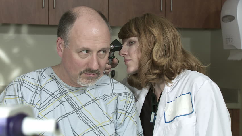 Two clips, close up of female doctor checking the ears of a mature male patient. - HD stock video clip