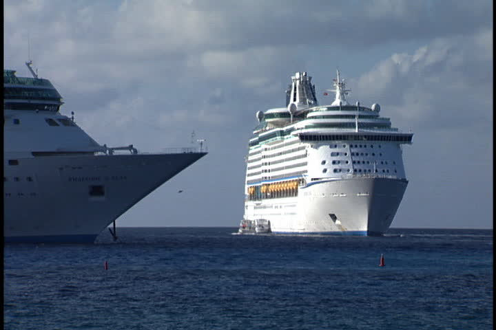 GRAND CAYMAN, CAYMAN ISLANDS - DECEMBER 11, 2003: Two cruise ships anchored off the coast of Grand Cayman Island.