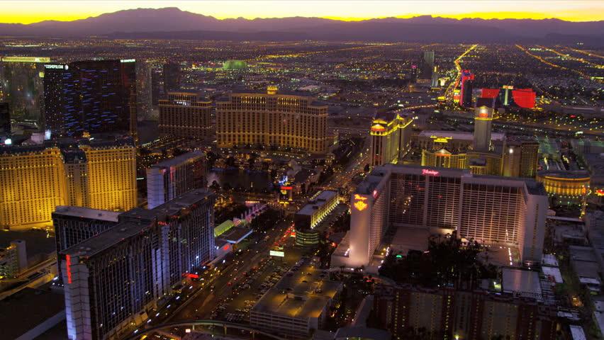 Las Vegas - January 2013: Aerial view sunset Las Vegas illuminated city Hotels and Casinos, Las Vegas, Nevada, USA, RED EPIC | Shutterstock HD Video #4243226