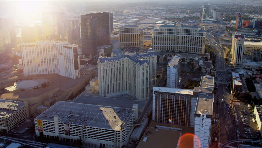 Las Vegas - January 2013: Aerial Hotel and Casino view with sun, flare lens, Las Vegas, Nevada, USA, RED EPIC | Shutterstock HD Video #4243235