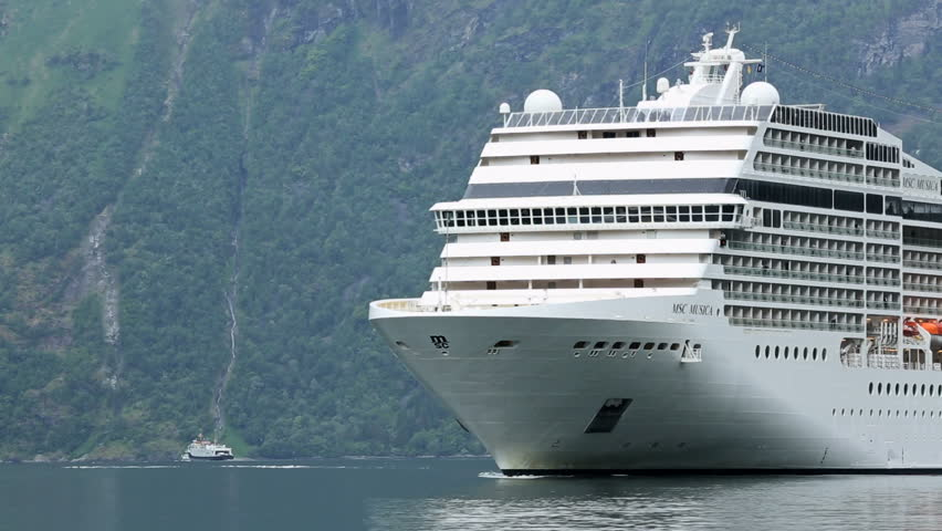 GEIRANGERFJORD, NORWAY - 12 JUNE 2013: Cruise ship approaching Geiranger in
