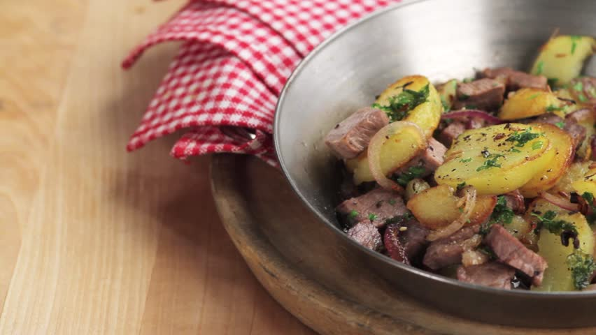 Grostl (typical Tirolean dish using leftovers) - HD stock video clip