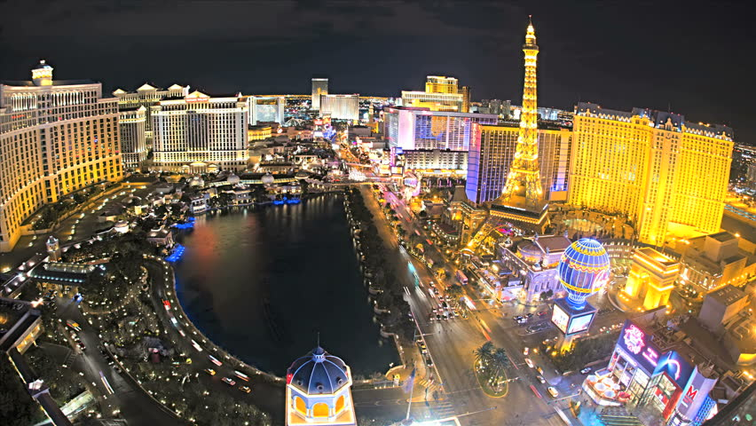 Las Vegas - January 2013: Illuminated view Bellagio Hotel nr Caesars Palace, Las Vegas Strip, USA, Time Lapse | Shutterstock HD Video #4262531