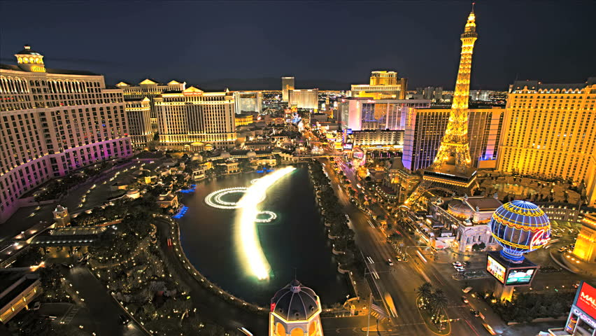 Las Vegas - January 2013: Illuminated view Bellagio Hotel fountains nr Paris Hotel, Las Vegas Strip, USA, Time Lapse | Shutterstock HD Video #4262540
