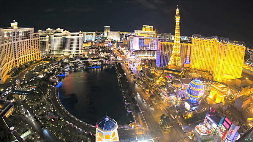 Las Vegas - January 2013: Illuminated view Bellagio Hotel nr Caesars Palace, Las Vegas Strip, USA, Time Lapse | Shutterstock HD Video #4262558
