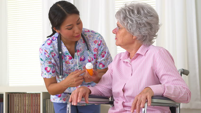 Japanese caregiver advising patient - HD stock footage clip