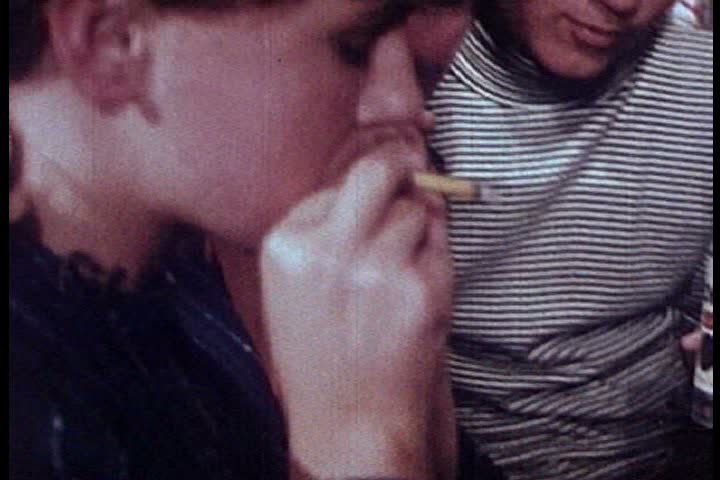 1960s - A group of young people smoke marijuana at a party during the 1960s