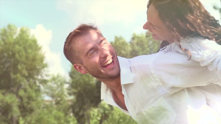 Happy Couple Having Fun Outdoors. Laughing Joyful Family. Freedom Concept.