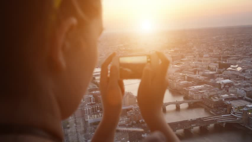 Tourist taking photograph of sunset in london skyline view from The Shard #4291106