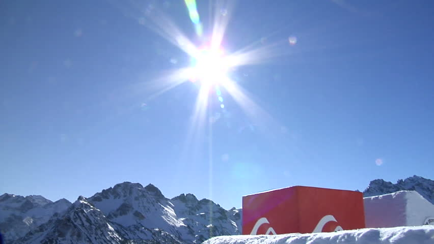 snowboarder jumps through sun in the blue sky - HD stock video clip