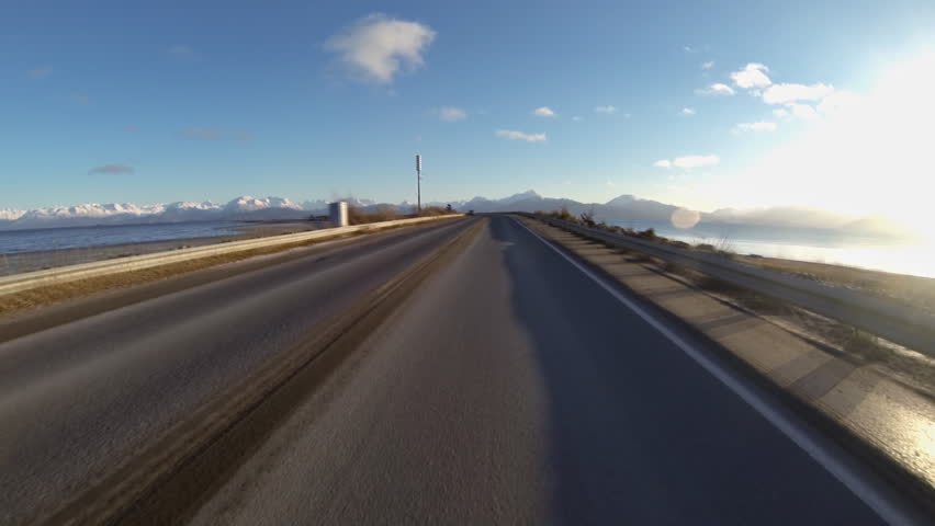 Driving POV on isolated Homer Spit Road, Homer, Alaska