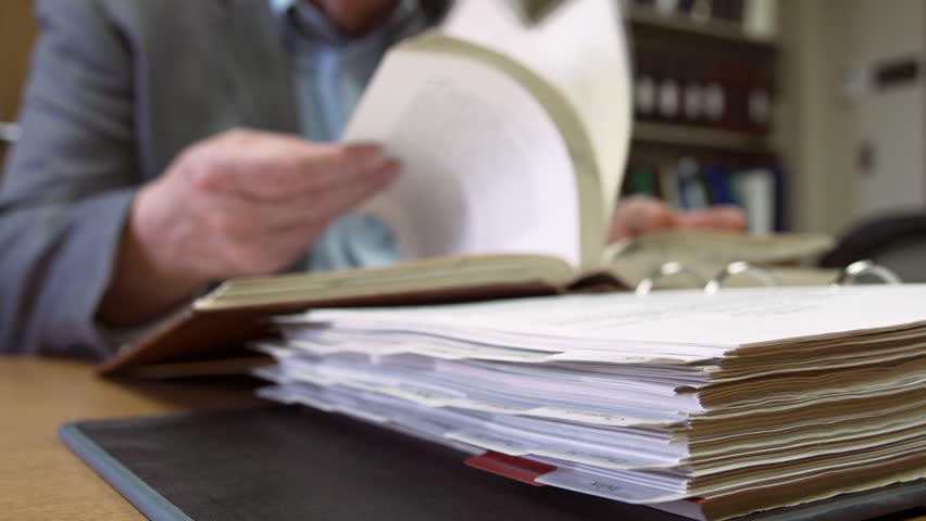 Man conducts legal research in library  - HD stock video clip