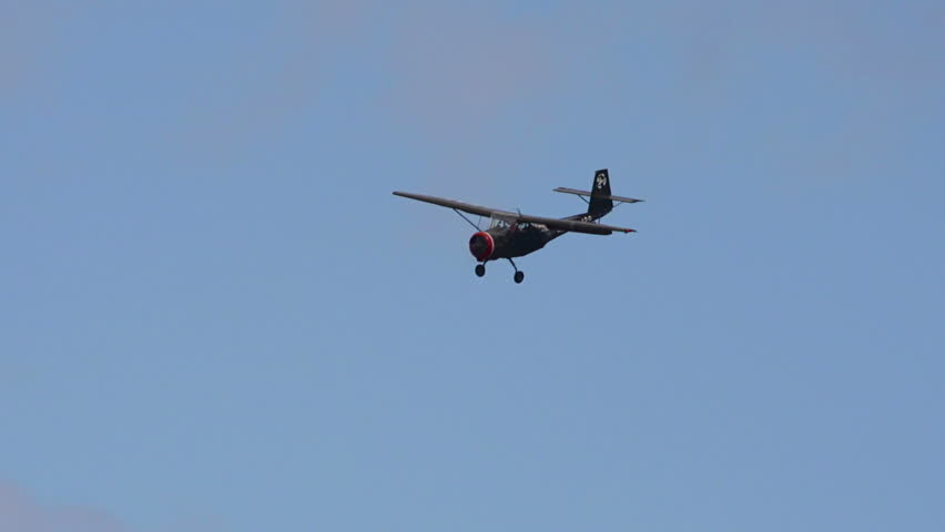 HOMER, AK - MAY 2013 - Functional vintage restored World War 2 aircraft flies in cloudy blue skies in May 2013 in Homer, Alaska - HD stock footage clip