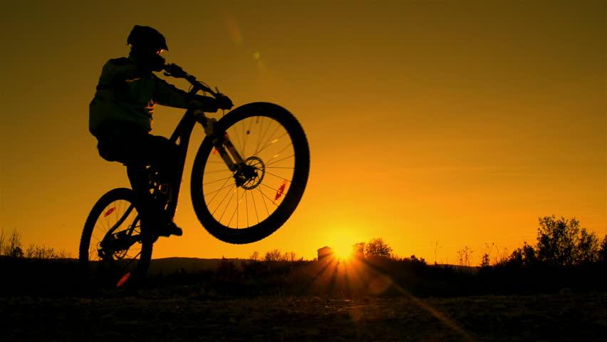 Slow Motion Mountain Biker Riding Wheelie Stock Footage