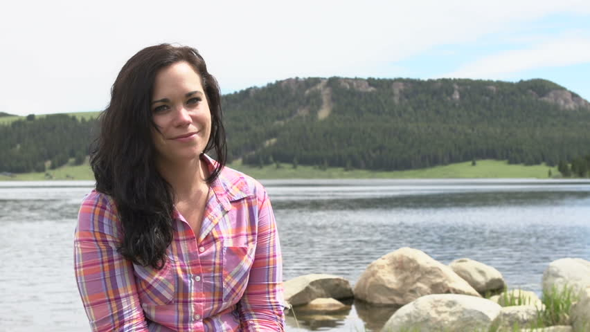Happy girl gets bit by mosquito at lake - HD stock video clip