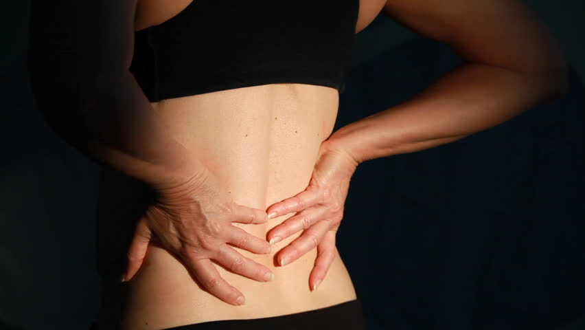 A close up of a woman back who is dealing with backache. - HD stock footage clip
