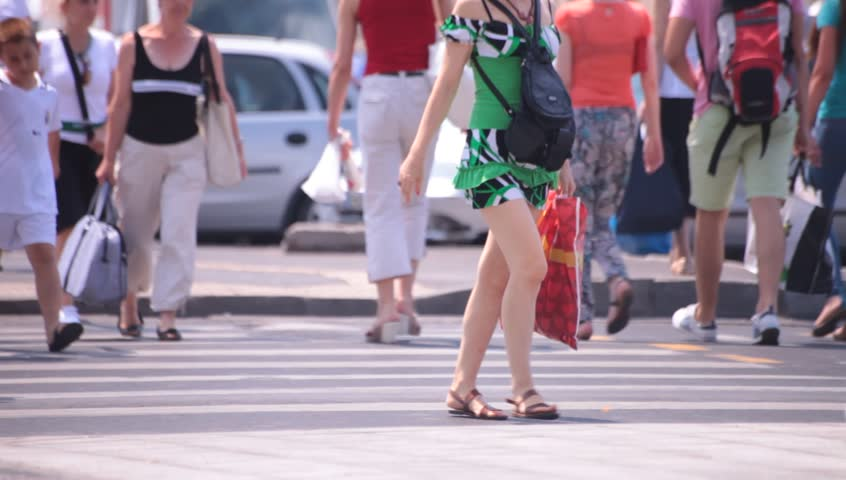 Hot sexy legs of young adult women walking down the street. Hot summer weather.  | Shutterstock HD Video #4345196