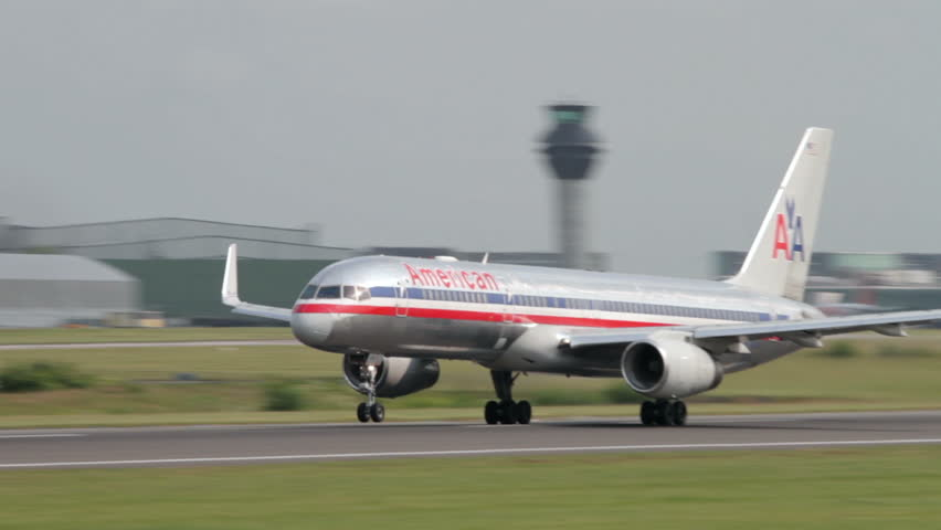 MANCHESTER, LANCASHIRE/ENGLAND - JULY 05: American Airlines Boeing 757 takes off from Manchester Airport on July 05, 2013 in Manchester. AA is a major US airline headquartered in Fort Worth, Texas.