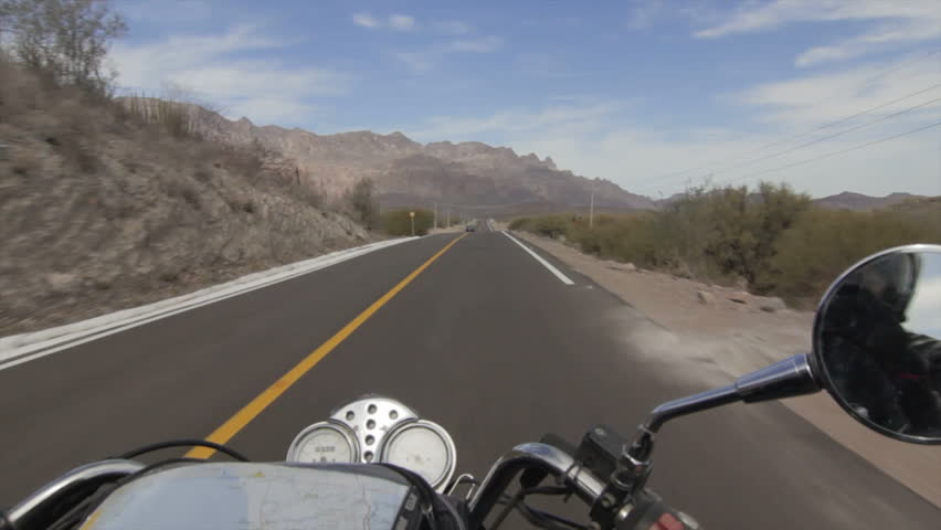 View over the handlebars of a speeding motorcycle pov - HD stock footage clip
