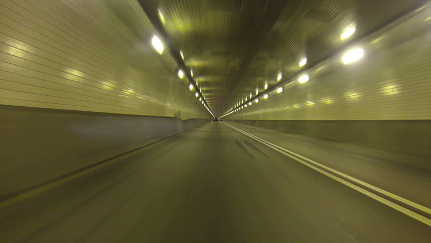 Low-angle perspective of driving inside the Fort Pitt Tunnels in Pittsburgh,