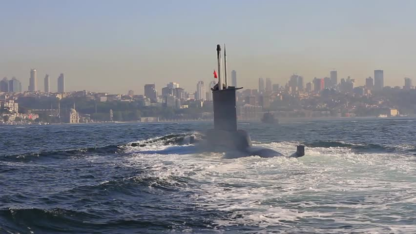 Riding on the wake of the submarine. Navy Submarine moving into Bosporus waters. Tracking shot.   - HD stock video clip