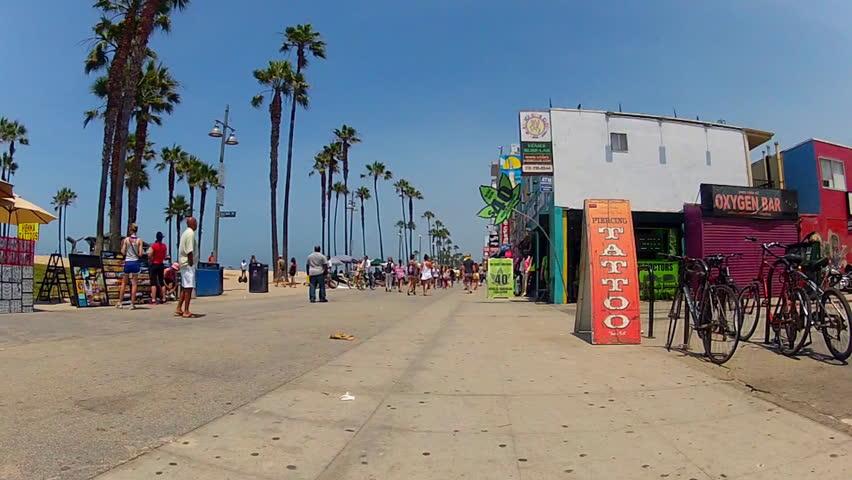 VENICE BEACH, CA/USA: July 18, 2013- The camera rolls down the boardwalk past a