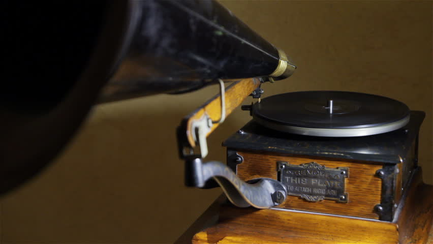 Old gramophone playing vinyl disc, closeup.